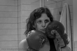 woman boxing at herself